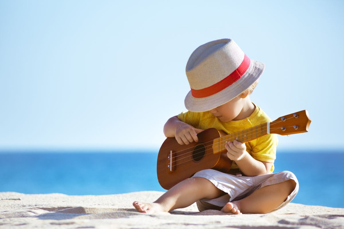 Little,Boy,Plays,On,Hawaiian,Guitar,Or,Ukulele,At,Sea